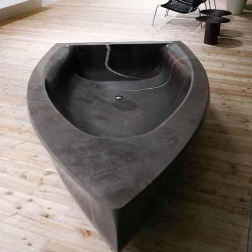 Boat-shaped stone bathtub by Antonio Lupi